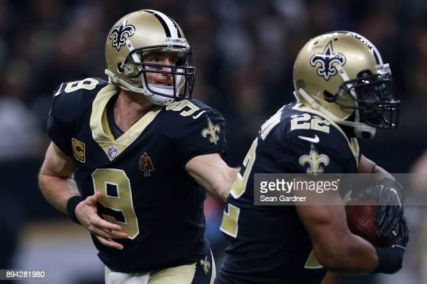 Quarterback Drew Brees of the New Orleans Saints hands the ball to running back Mark Ingram during the first half of a game against the New York Jets...