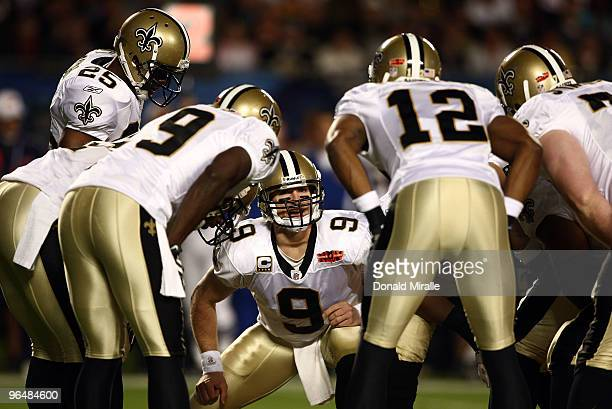 Quarterback Drew Brees of the New Orleans Saints huddles with his team against the Indianapolis Colts during Super Bowl XLIV on February 7 2010 at...
