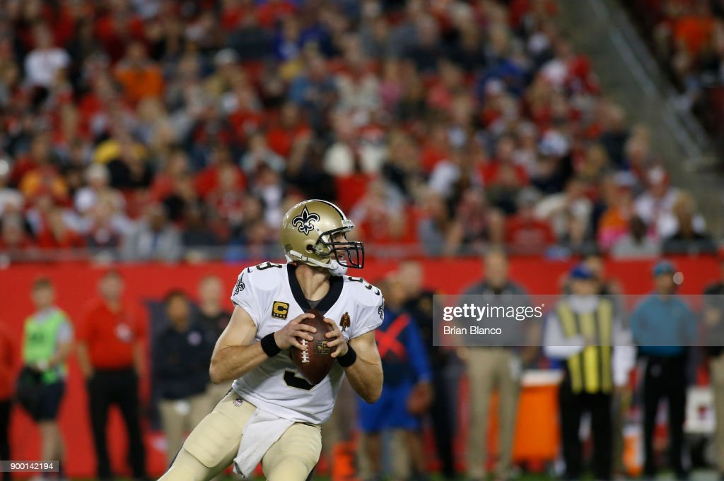 Quarterback Drew Brees #9 of the New Orleans Saints looks for a receiver during the third quarter of an NFL football game against the Tampa Bay Buccaneers on December 31, 2017 at Raymond James Stadium in Tampa, Florida.