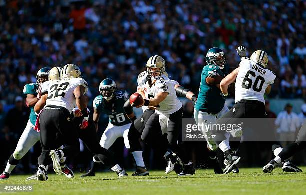 Quarterback Drew Brees of the New Orleans Saints looks to hand off to Mark Ingram against the Philadelphia Eagles in the third quarter during a...
