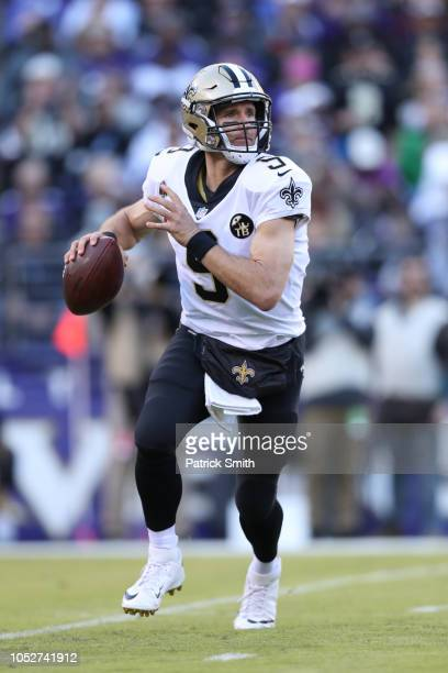 Quarterback Drew Brees of the New Orleans Saints looks to pass against the Baltimore Ravens at MT Bank Stadium on October 21 2018 in Baltimore...