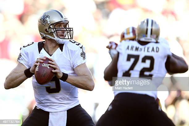 Quarterback Drew Brees of the New Orleans Saints passes while tackle Terron Armstead of the New Orleans Saints blocks against the Washington Redskins...