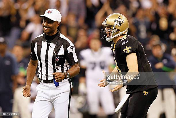 Quarterback Drew Brees of the New Orleans Saints pleads to referee Mike Carey on a holding call against Brees' offense during the game against the...