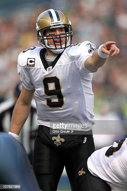 Quarterback Drew Brees of the New Orleans Saints points from under center in the second quarter against the Seattle Seahawks during the 2011 NFC...