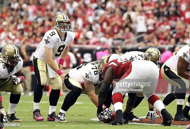 Quarterback Drew Brees of the New Orleans Saints prepares to snap the ball during the NFL game against the Arizona Cardinals at the University of...