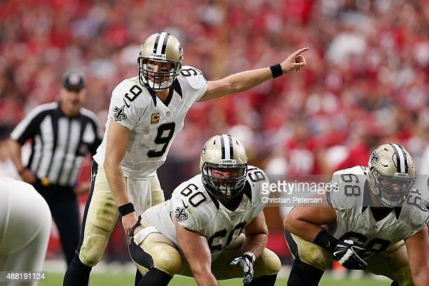 Quarterback Drew Brees of the New Orleans Saints prepares to snap the football during the NFL game against the Arizona Cardinals at the University of...
