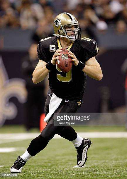 Quarterback Drew Brees of the New Orleans Saints rolls out during the game against the Tampa Bay Buccaneers on December 27 2009 at Louisiana...