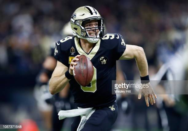 Quarterback Drew Brees of the New Orleans Saints runs with the ball during the second quarter of the game against the Los Angeles Rams at...