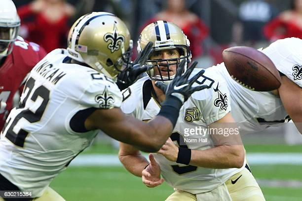 Quarterback Drew Brees of the New Orleans Saints tosses the football to running back Mark Ingram in the first half of the NFL game against the...