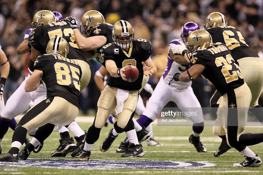 Quarterback Drew Brees #9 of the New Orleans Saints turns to hand the ball off to Pierre Thomas #23 against the Minnesota Vikings during the NFC Championship Game at the Louisiana Superdome on January 24, 2010 in New Orleans, Louisiana. The Saints won 31-28 in overtime.