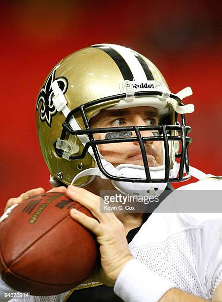 Quarterback Drew Brees of the New Orleans Saints warms up before facing the Atlanta Falcons at Georgia Dome on December 13 2009 in Atlanta Georgia