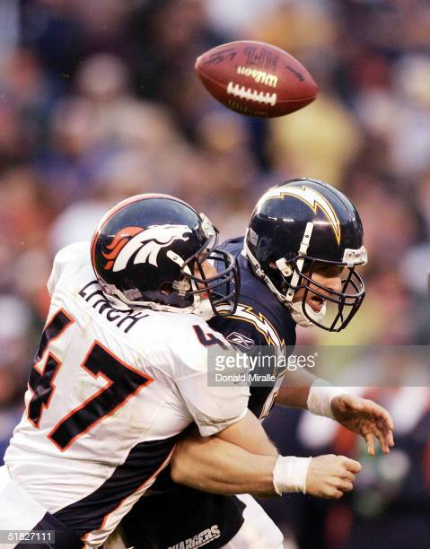 Quarterback Drew Brees of the San Diego Chargers gets sacked by John Lynch of the Denver Broncos resulting in a fumble during their NFL Game at...