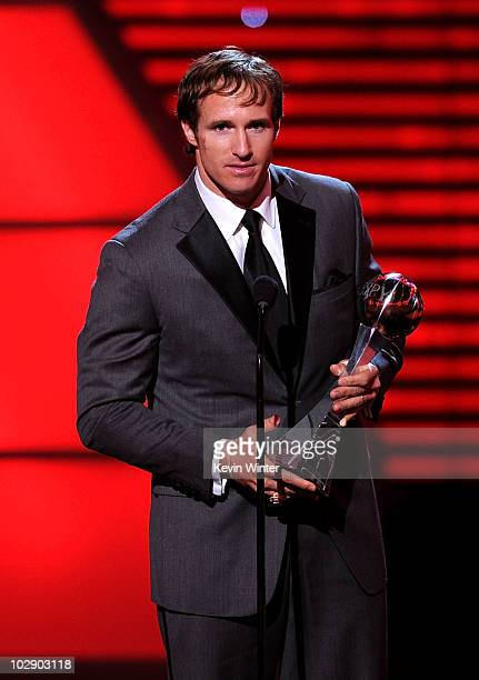 NFL quarterback Drew Brees speaks onstage after winning the ESPY for Best Male Athlete during the 2010 ESPY Awards at Nokia Theatre LA Live on July...