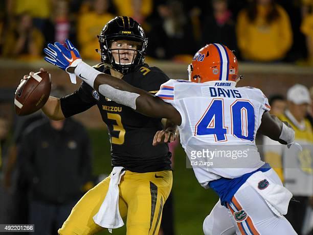 Quarterback Drew Lock of the Missouri Tigers avoids a sack by linebacker Jarrad Davis of the Florida Gators in the third quarter at Memorial Stadium...