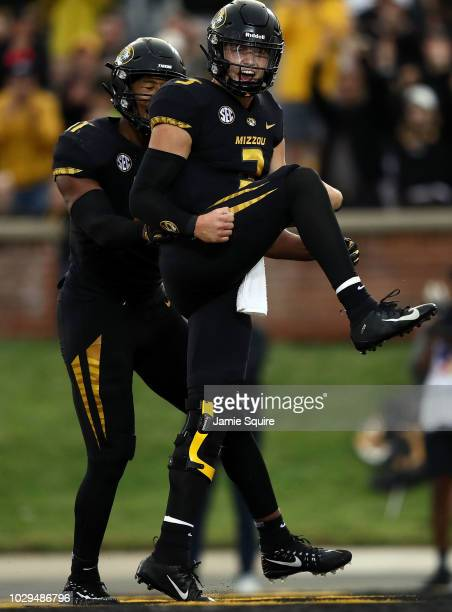 Quarterback Drew Lock of the Missouri Tigers celebrates after crossing the goal line for a touchdown during the 1st half of the game against the...