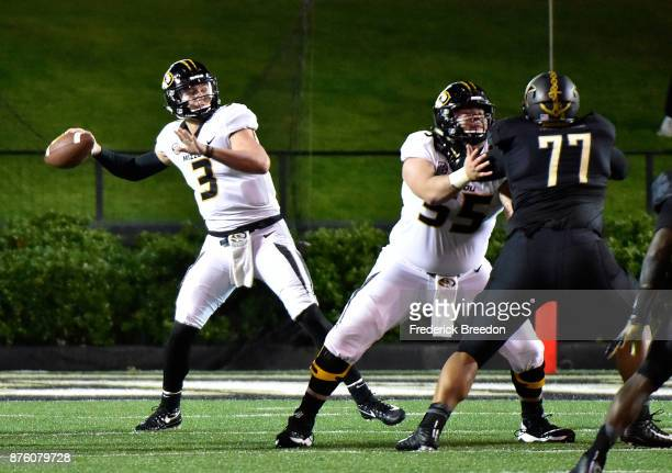 Quarterback Drew Lock of the Missouri Tigers drops back to thorw a long pass against Nifae Lealao of the Vanderbilt Commodores during the first half...