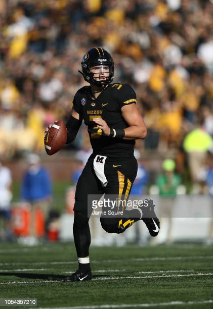 Quarterback Drew Lock of the Missouri Tigers looks to pass during the game against the Kentucky Wildcats at Faurot Field/Memorial Stadium on October...