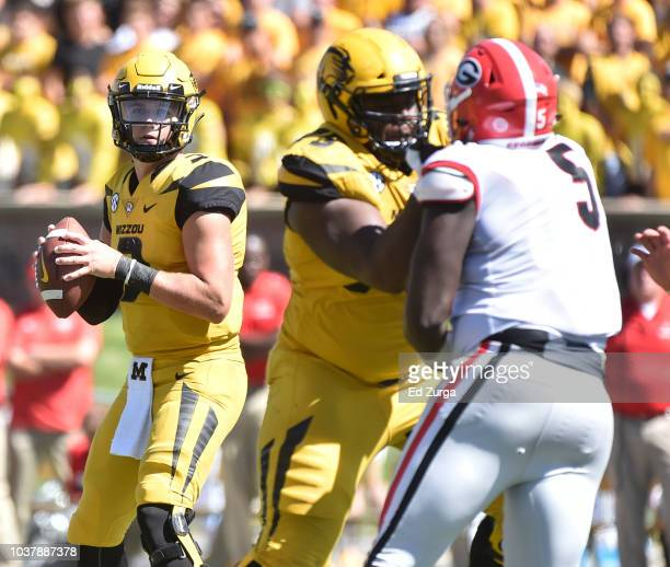 Quarterback Drew Lock of the Missouri Tigers looks to pass in the third quarter against the Georgia Bulldogs at Memorial Stadium on September 22 2018...