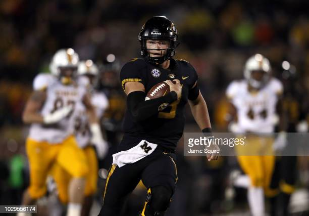 Quarterback Drew Lock of the Missouri Tigers scrambles during the game against the Wyoming Cowboys at Faurot Field/Memorial Stadium on September 8...