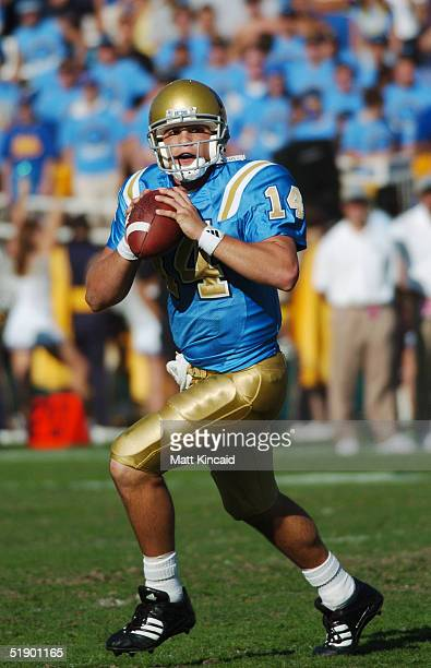 Quarterback Drew Olson of the UCLA Bruins looks to pass against the Stanford Cardinal at the Rose Bowl on October 30 2004 in Pasadena California UCLA...