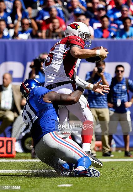 Quarterback Drew Stanton of the Arizona Cardinals is sacked by defensive end Robert Ayers of the New York Giants during a game at MetLife Stadium on...