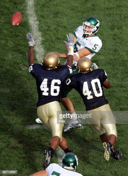 Quarterback Drew Stanton of the Michigan State Spartans is pressured by linebackers Corey Mays and Maurice Crum Jr #40 of the Notre Dame Fighting...