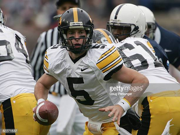 Quarterback Drew Tate of the Iowa Hawkeyes looks to handoff against the Penn State Nittany Lions during the game at Beaver Stadium on October 23 2004...