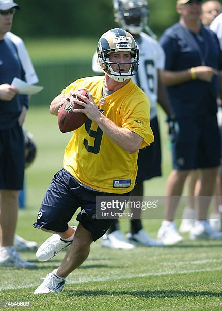 Quarterback Drew Tate of the St. Louis Rams drops back to pass at the St. Louis Rams Mini-Camp on May 12, 2007 at the St. Louis Rams Training...