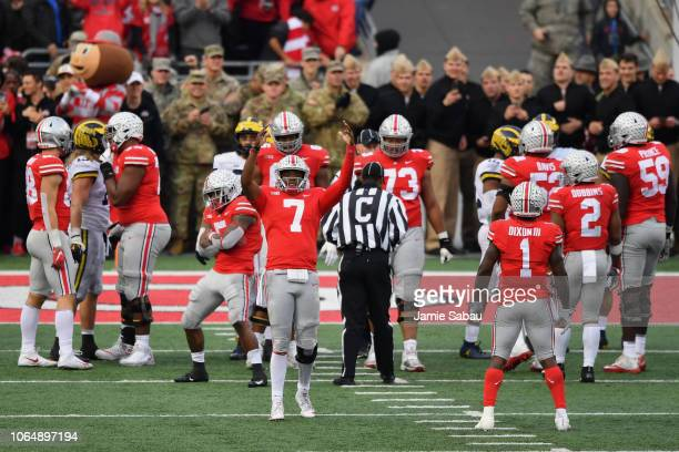 Quarterback Dwayne Haskins of the Ohio State Buckeyes celebrates with the crowd as time winds down in the fourth quarter against the Michigan...