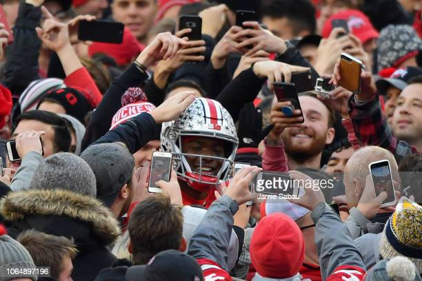 Quarterback Dwayne Haskins of the Ohio State Buckeyes is congratulated by fans as he walks off the field after defeating the Michigan Wolverines at...