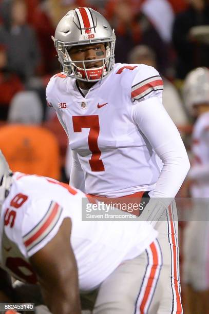 Quarterback Dwayne Haskins of the Ohio State Buckeyes looks over the line against the Nebraska Cornhuskers at Memorial Stadium on October 14 2017 in...