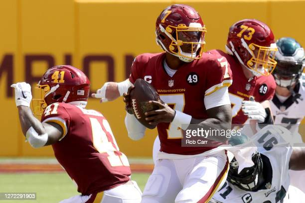 Quarterback Dwayne Haskins of the Washington Football Team drops back to pass against the Philadelphia Eagles in the firsts half at FedExField on...