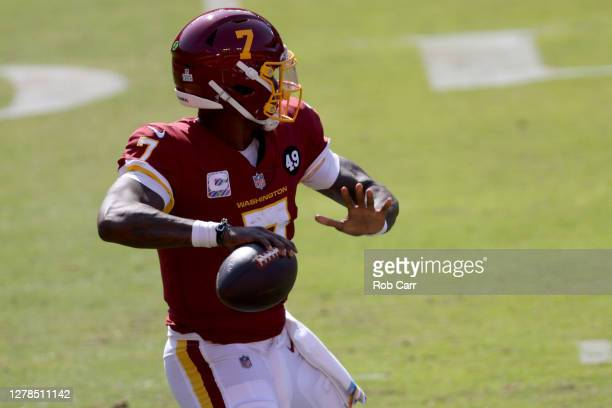 Quarterback Dwayne Haskins of the Washington Football Team passes against the Baltimore Ravens in the first half at FedExField on October 04 2020 in...