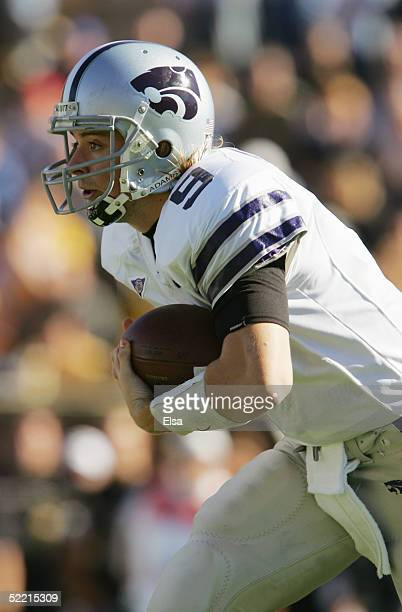 Quarterback Dylan Meier of the Kansas State University Wildcats scrambles with the ball against the University of Missouri Tigers during the game on...