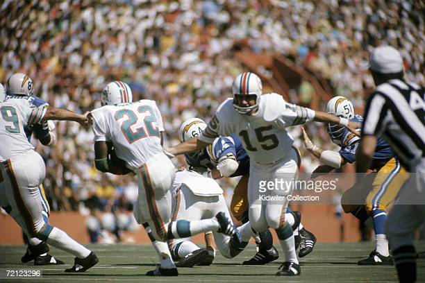 Quarterback Earl Morrall of the Miami Dolphins hands the ball off to runningback Mercury Morris during a game on October 15 1972 against the San...