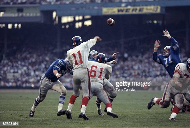 Quarterback Earl Morrall of the New York Giants throws a pass as defensive lineman Alex Karras of the Detroit Lions tries to block it during a...