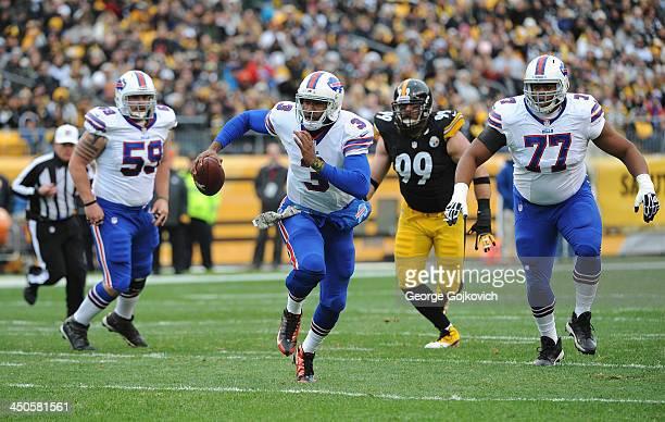 Quarterback EJ Manuel of the Buffalo Bills runs with the football as teammates Doug Legursky and Cordy Glenn and defensive lineman Brett Keisel of...