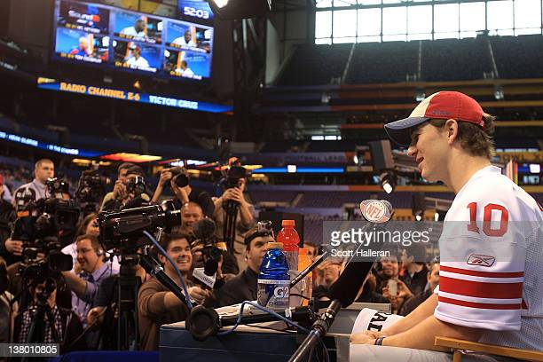 Quarterback Eli Manning of the New York Giants answers question from the media during Media Day ahead of Super Bowl XLVI against the New England...