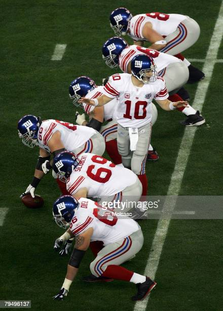 Quarterback Eli Manning of the New York Giants calls back to his running back against the New England Patriots during Super Bowl XLII on February 3,...