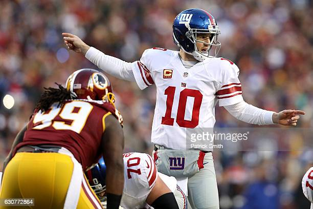 Quarterback Eli Manning of the New York Giants calls from the line of scrimmages against defensive end Ricky Jean Francois of the Washington Redskins...