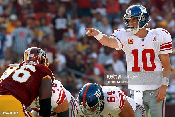 Quarterback Eli Manning of the New York Giants calls out from under center against the Washington Redskins in the second quarter at FedExField on...