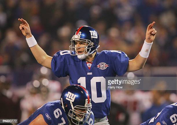 Quarterback Eli Manning of the New York Giants calls signals at the line of scrimmage during the game against the Atlanta Falcons at Giant Stadium on...