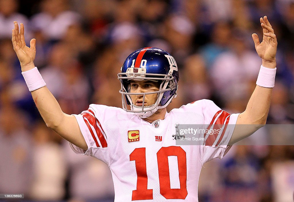 Quarterback Eli Manning #10 of the New York Giants celebrates after Runningback Ahmad Bradshaw #44 ran the ball for a 6 yard touchdown in the fourth quarter against the New England Patriots during Super Bowl XLVI at Lucas Oil Stadium on February 5, 2012 in Indianapolis, Indiana. The Giants defeated the Patriots 21-17.