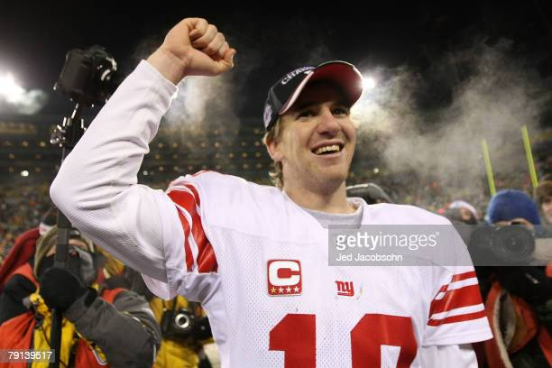 Quarterback Eli Manning of the New York Giants celebrates after winning the NFC championship game against the Green Bay Packers on January 20 2008 at...