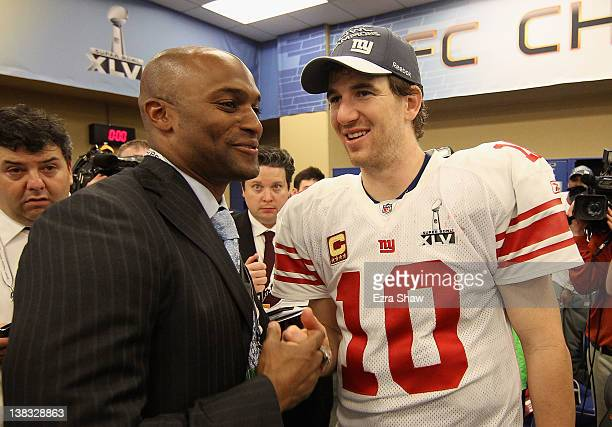 Quarterback Eli Manning of the New York Giants celebrates with Amani Toomer after the Giants defeated the Patriots by a score of 2117 in Super Bowl...