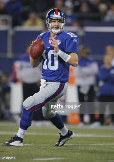 Quarterback Eli Manning of the New York Giants drops back to pass during the game against the Atlanta Falcons at Giant Stadium on November 21, 2004...