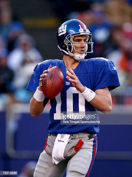 Quarterback Eli Manning of the New York Giants drops back to pass against the New Orleans Saints on December 24, 2006 at Giants Stadium in East...