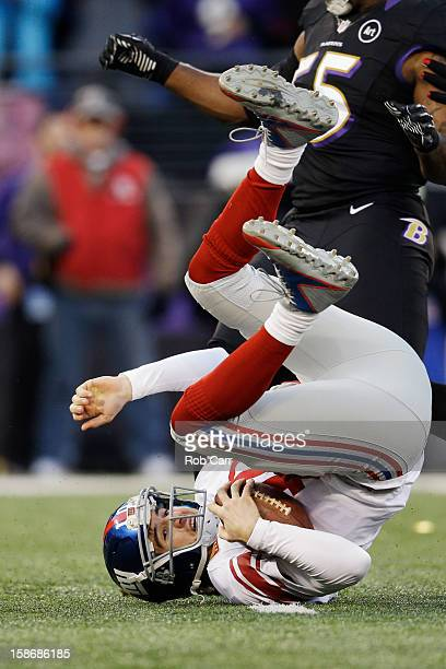 Quarterback Eli Manning of the New York Giants hits the turf after being sacked by the Baltimore Ravens during the first half at M&T Bank Stadium on...