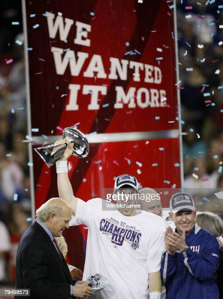 Quarterback Eli Manning of the New York Giants holds the Vince Lombardi Trophy after defeating the New England Patriots 17 14 in Super Bowl XLII on...