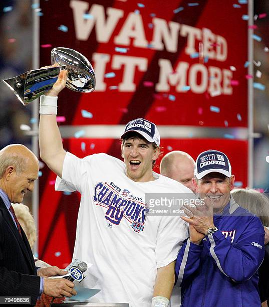Quarterback Eli Manning of the New York Giants holds the Vince Lombardi Trophy after defeating the New England Patriots 17 0 14 after Super Bowl XLII...
